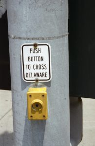 "Sign: ""Push Button to Cross Delaware"""