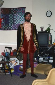 Jed in madrigal-singer costume