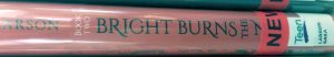 A book spine, with the end of the title obscured by stickers. The author is Larson, and the spine reads 'Book Two: Bright Burns the N-'